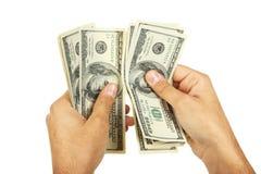 Mężczyzna wręczają mieniu sto dolarów rachunku na białym tle Fotografia Royalty Free