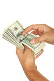Mężczyzna wręczają mieniu sto dolarów rachunku na białym tle Obrazy Stock