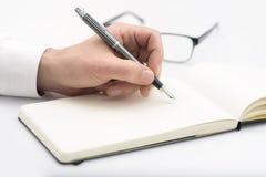 Mężczyzna writing Obraz Royalty Free