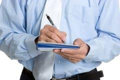 Mężczyzna Writing Czek Zdjęcia Stock
