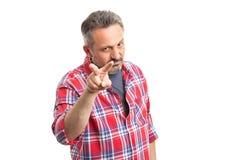 Mężczyzna wskazuje palce przy kamerą obraz stock