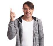 Mężczyzna wskazuje up w sportswear odosobniony zdjęcie royalty free