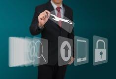 Mężczyzna wybrana komputerowa ikona na dotyka ekranie Zdjęcie Royalty Free