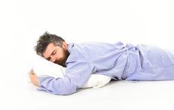 Mężczyzna z śpiącą twarzą kłama na poduszce fotografia stock