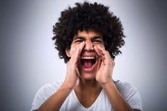 Mężczyzna z afro krzyczeć Obrazy Royalty Free