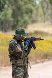 Mężczyzna z AK chwytami przy gunpoint Obrazy Royalty Free