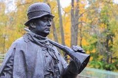 Mężczyzna z armatnią rzeźbą Zdjęcie Royalty Free