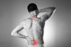 Mężczyzna z backache Ból w mężczyzna ciele obraz stock
