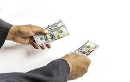 Mężczyzna z dolarowym rachunkiem lub banknotem obraz royalty free