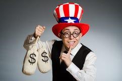 Mężczyzna z dolarowymi pieniędzy workami Obrazy Stock