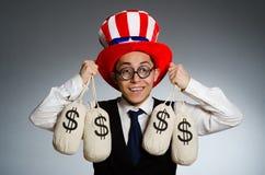 Mężczyzna z dolarowymi pieniędzy workami Obrazy Royalty Free