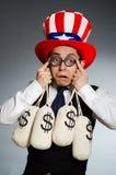 Mężczyzna z dolarowymi pieniędzy workami Zdjęcia Royalty Free