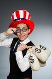 Mężczyzna z dolarowymi pieniędzy workami Zdjęcie Stock