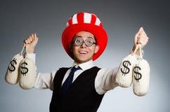 Mężczyzna z dolarowymi pieniędzy workami Zdjęcia Stock