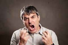 Mężczyzna z gniewnym wyrażeniem zdjęcie stock