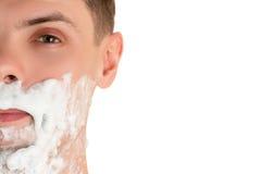 mężczyzna z golenie pianą na jego twarzy Zdjęcia Royalty Free