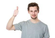 Mężczyzna z kciukiem up gestykuluje Zdjęcia Stock