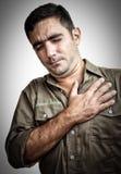 Mężczyzna z klatki piersiowej bólem lub mieć atak serca Zdjęcia Stock