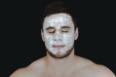 Mężczyzna z kremowym moisturizer na jego twarzy Obraz Royalty Free