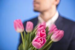 Mężczyzna Z Kwiatami Obrazy Stock