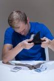 Mężczyzna z pieniężnymi problemami Zdjęcie Royalty Free
