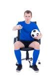 Mężczyzna z pilot do tv dopatrywania meczem piłkarskim odizolowywającym na bielu Obraz Royalty Free