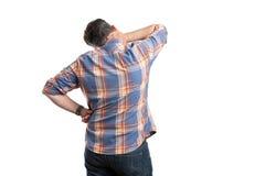 Mężczyzna z z powrotem kamery wzruszająca szyja zdjęcie royalty free