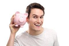 Mężczyzna z prosiątko bankiem obraz royalty free