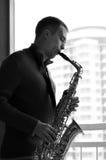 Mężczyzna z saksofonem Zdjęcia Royalty Free
