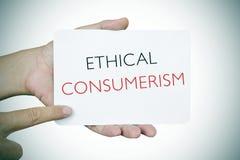 Mężczyzna z signboard z teksta etycznym konsumeryzmem, winieta Fotografia Stock