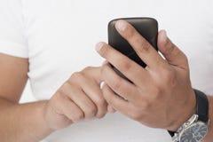 Mężczyzna z smartphone obraz stock