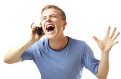 Mężczyzna z telefonu komórkowego i pieniądze śmiać się. Obraz Stock