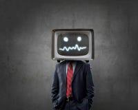 Mężczyzna z TV zamiast głowy Mieszani środki obrazy royalty free