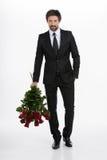 Mężczyzna z wiązką róże. Zdjęcie Stock