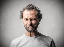 Mężczyzna z zdegustowanym wyrażeniem zdjęcie royalty free