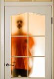 Mężczyzna za Szklanym drzwi Zdjęcie Stock