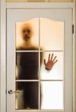 Mężczyzna za Szklanym drzwi Obraz Royalty Free