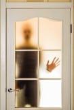 Mężczyzna za Szklanym drzwi Obraz Stock