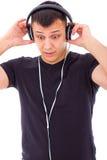 Mężczyzna zaskakujący coś niespodziewanym na hełmofonach Zdjęcia Stock