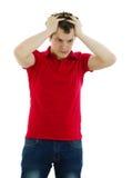 Mężczyzna zaskakuje i chwyta jego głowę Zdjęcia Stock