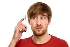 mężczyzna zmieszany telefon komórkowy Obrazy Royalty Free
