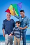 Męscy członkowie rodziny bawić się z kanią Fotografia Stock