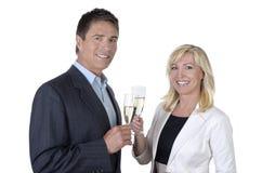 Męscy i żeńscy ludzie biznesu świętuje z szampanem Zdjęcia Stock