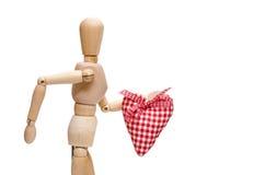 Męska drewniana postać trzyma czerwonego serce Fotografia Stock