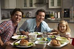 Męska homoseksualna para i córka łomota w domu spojrzenie kamera Zdjęcia Royalty Free