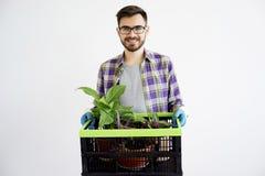 Męska ogrodniczka z roślinami Obraz Royalty Free