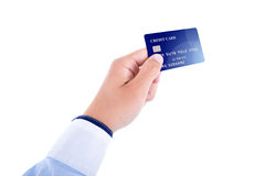 Męska ręka daje plastikowej kredytowej karcie odizolowywającej na bielu Obraz Stock