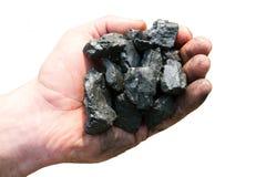 Męska ręka trzyma bary odizolowywający na białym tle czarna kopalnia węgla Zdjęcia Royalty Free