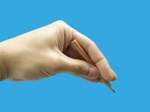 Męska ręka trzyma ołówek Zdjęcie Stock