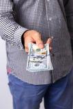 Męska ręka trzyma USA dolary Obrazy Stock